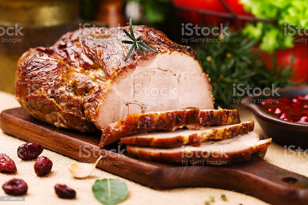 Roast pork with cranberry dip, basil, coriander and rosemary. stock photo