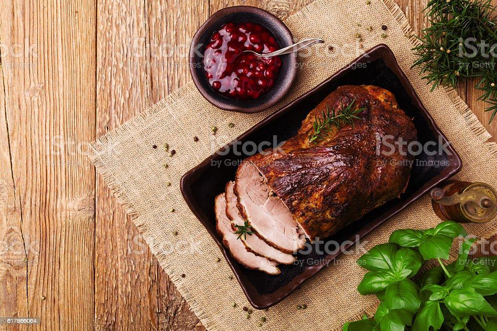 Roast pork with cranberry dip, basil, coriander and rosemary. stock photo