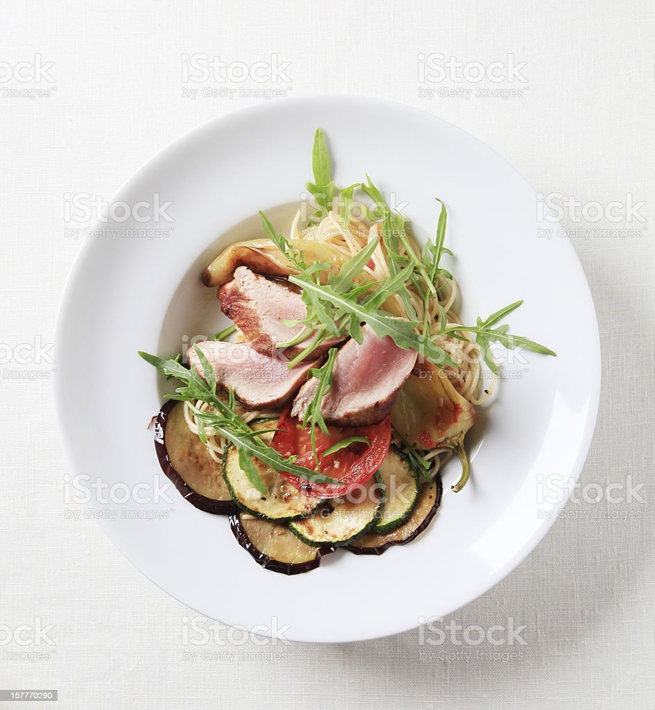 Roast pork with spaghetti and baked vegetables stock photo