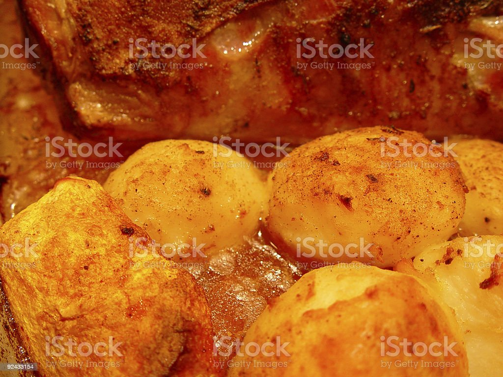 Roast potatoes and lamb royalty-free stock photo