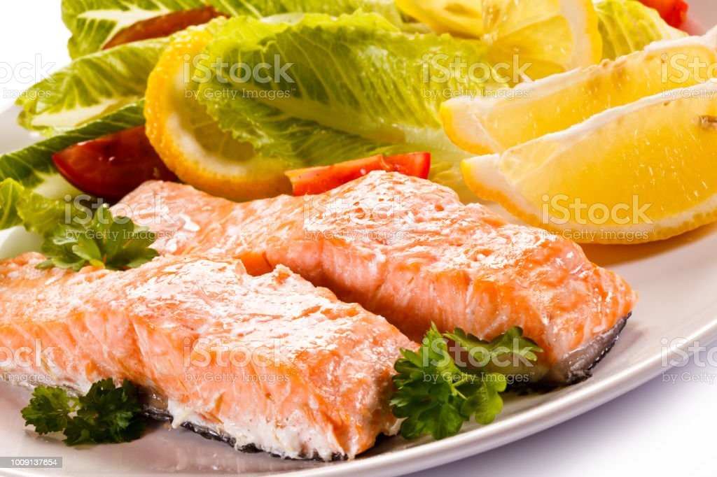 Roast salmon and vegetables stock photo