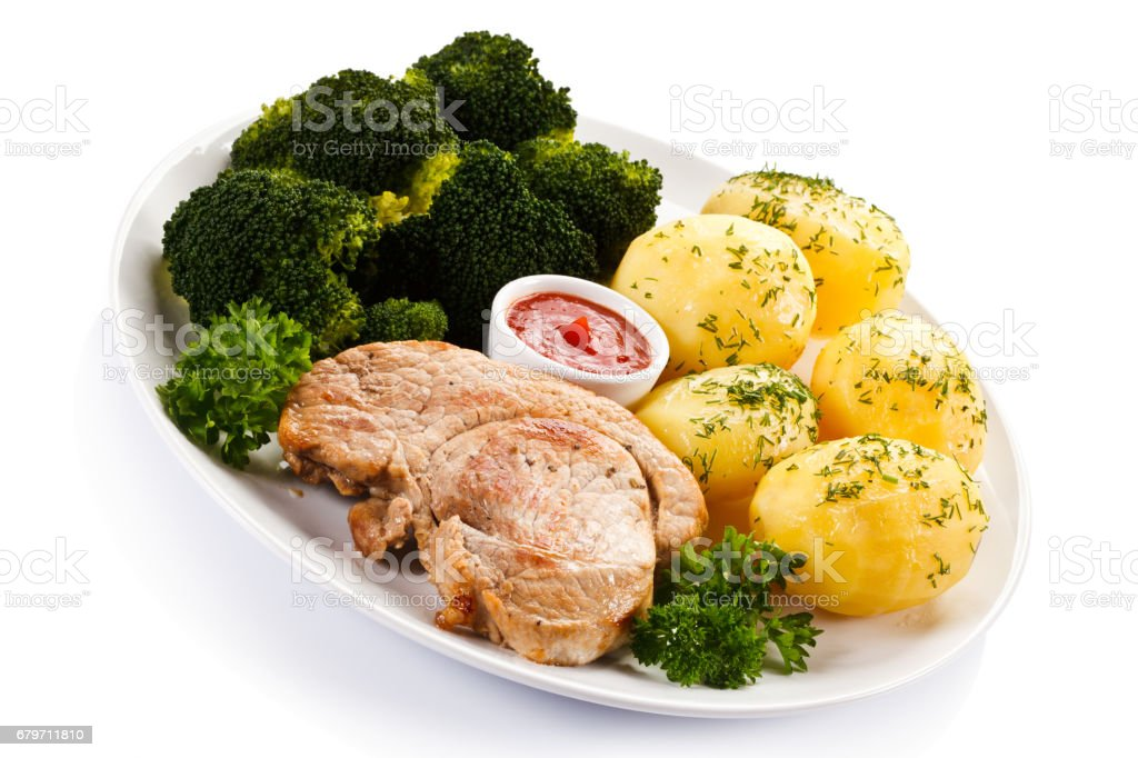 Roast steak with potatoes and broccoli stock photo