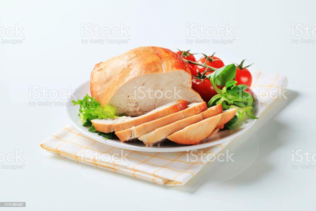 Roast turkey breast on a plate stock photo