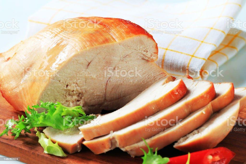 Roast turkey breast on cutting board stock photo