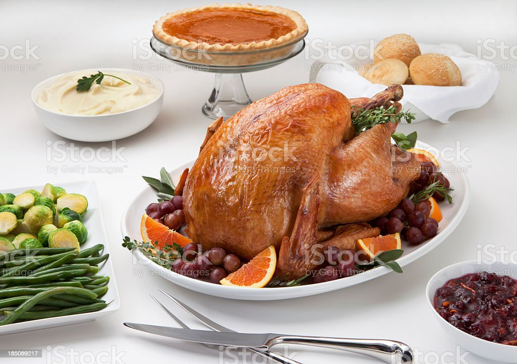Roast Turkey Dinner with Side Dishes and Pumpkin Pie. royalty-free stock photo