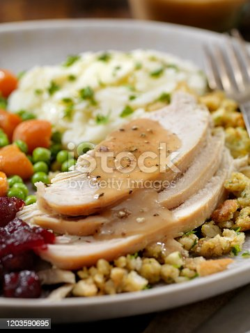 The Hungry Man's Roast Turkey Dinner With Stuffing,Mashed Potatoes, Cranberry Sauce, Peas, Carrots and Gravy