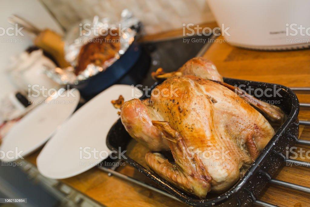 Roast Turkey Fresh Out Of Oven. Messy kitchen. Freshly roasted, dark...