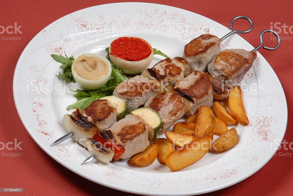 Roast turkey surrounded by potatoes and vegetables royalty-free stock photo