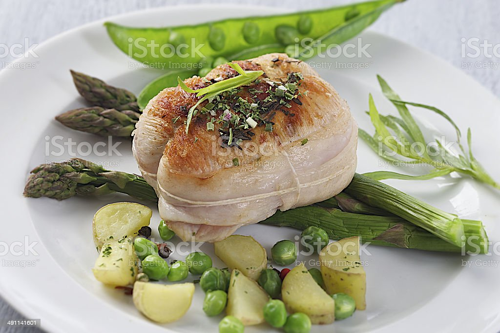 roast veal roulade with vegetable stock photo