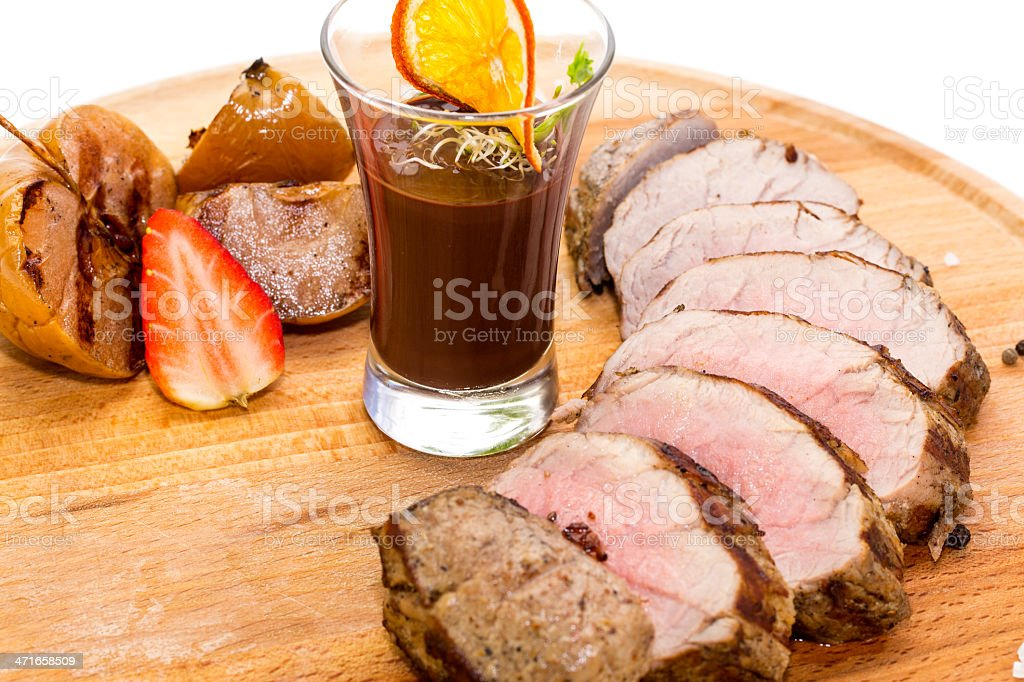 roast venison with vegetables and berry sauce royalty-free stock photo