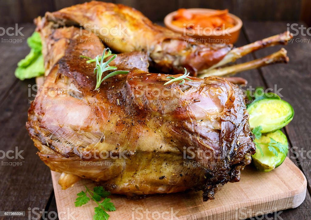 Roast whole rabbit on a wooden board stock photo