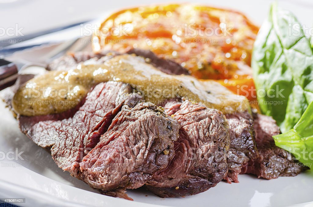 Roastbeef with salad, roasted tomato and pepper sauce royalty-free stock photo