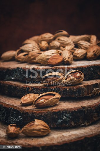 Nuts on a wooden background. Harvesting almonds. Vintage toning.
