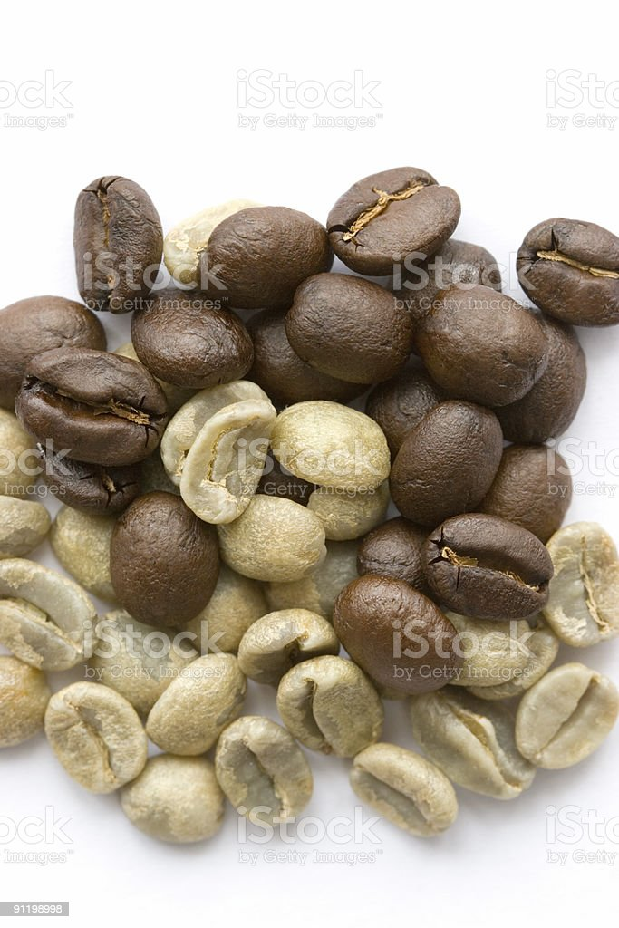 Roasted and Unroasted Coffee Beans royalty-free stock photo