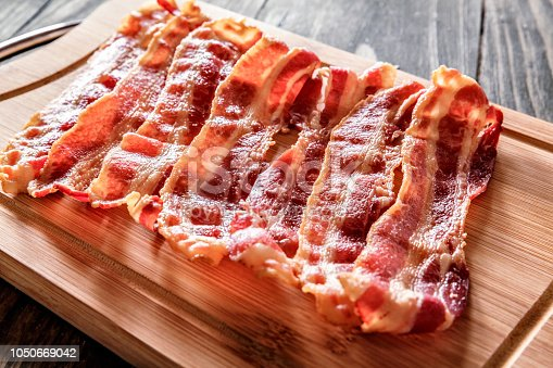 Roasted bacon on cutting board. Ingredient used in making Jam Bread or