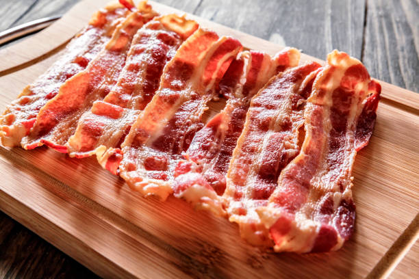 Roasted bacon on cutting board stock photo