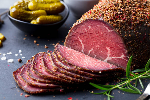roasted beef, pastrami on slate cutting board. close up. - pastrami stock pictures, royalty-free photos & images