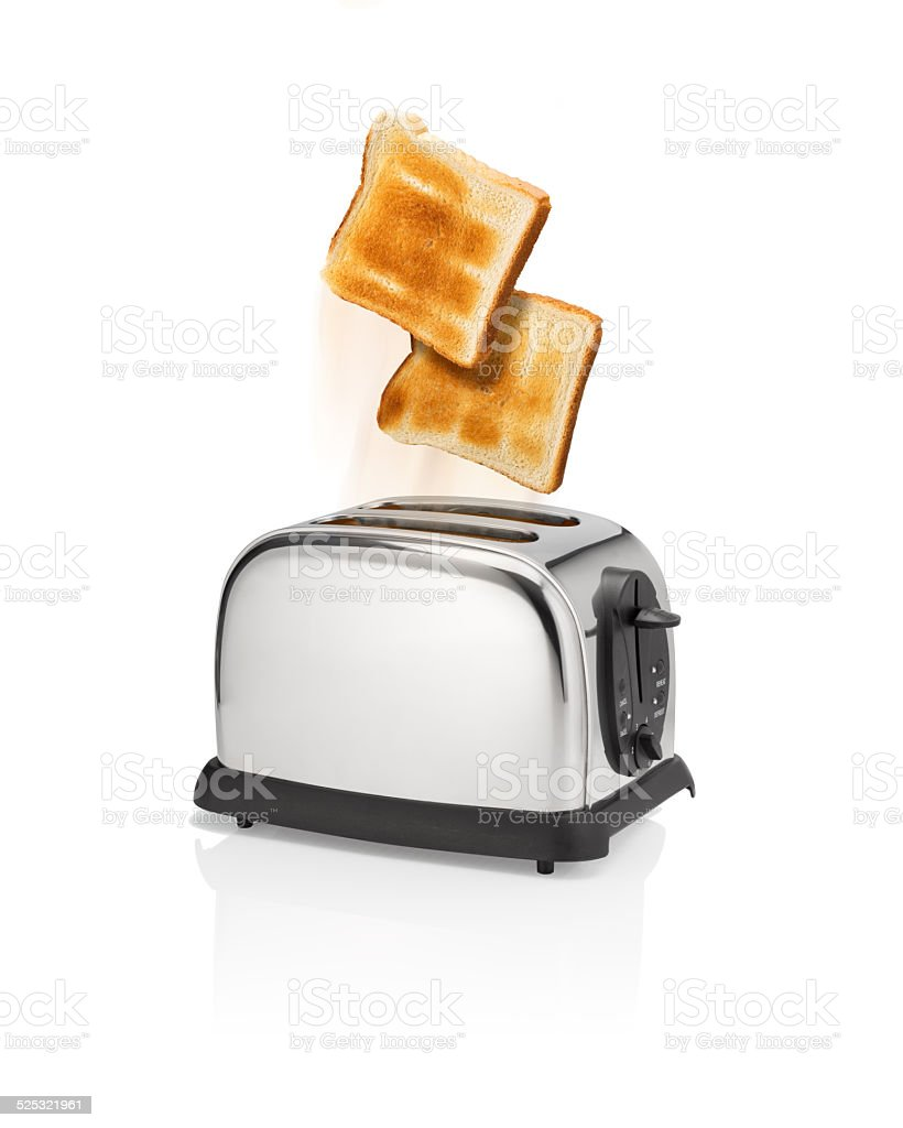 Roasted bread pops out from toaster. stock photo
