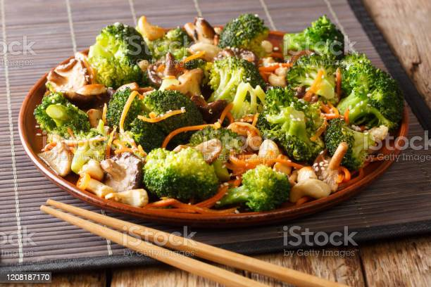 Roasted Broccoli Salad With Shiitake Carrots And Cashew Nuts Closeup In A Plate Horizontal Stock Photo - Download Image Now