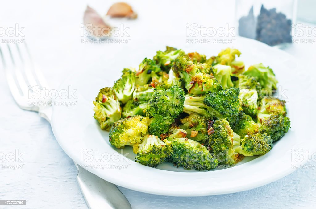 roasted broccoli with garlic stock photo