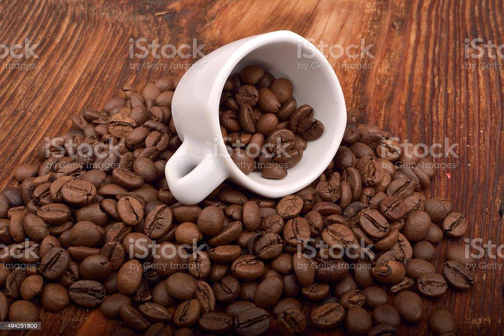 Fantastic Roasted Brown Coffee Beans Mug On Wooden Table Stock Photo Download Image Now Inzonedesignstudio Interior Chair Design Inzonedesignstudiocom