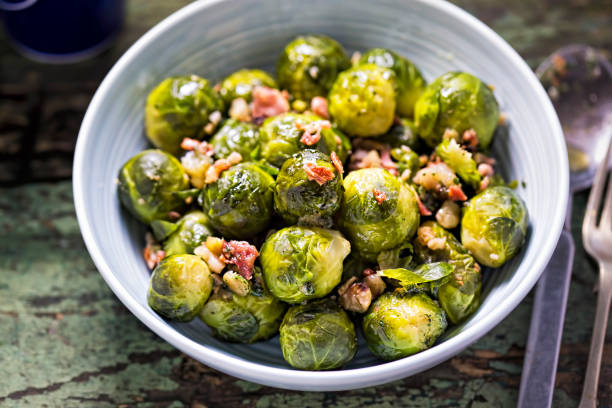 Roasted brussel sprouts with bacon stock photo