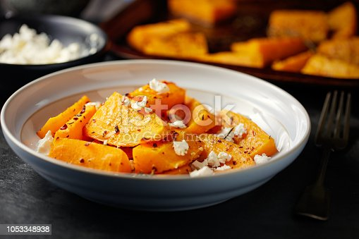 Home made freshness roasted butternut squash with thyme,rosemary,chilli flakes service with feta cheese