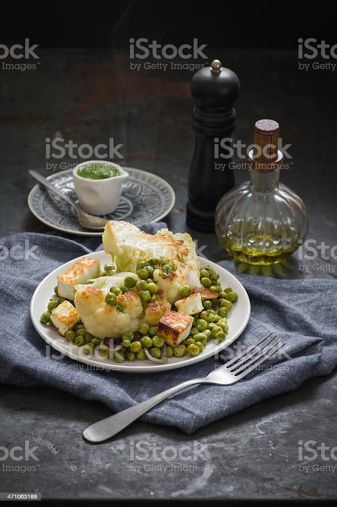 Roasted cauliflower with peas and green chuney stock photo
