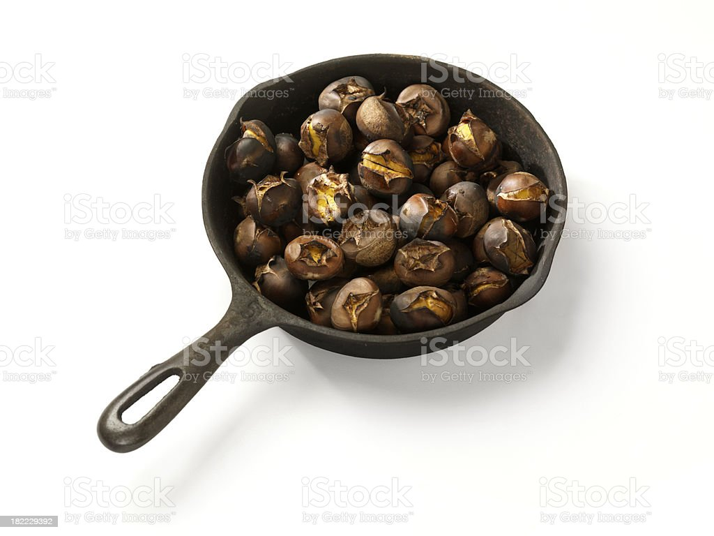 Roasted Chestnuts in a Cast Iron Pan stock photo