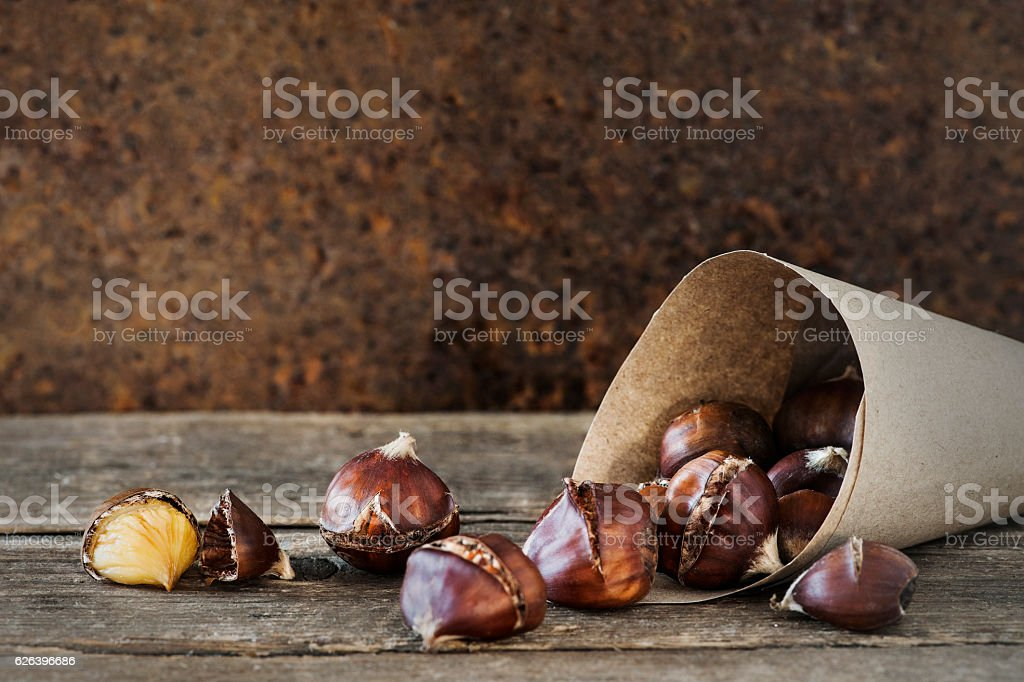 Roasted chestnuts in a paper bag stock photo