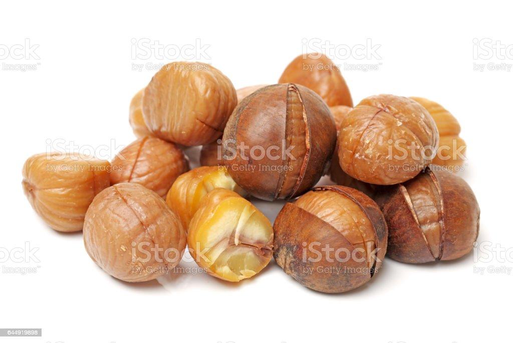 Roasted Chestnuts on white background stock photo