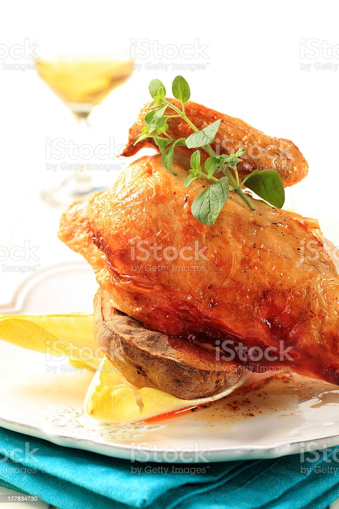 Roasted chicken and baked potato royalty-free stock photo
