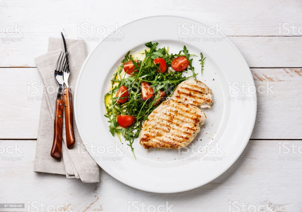 Roasted chicken breast and fresh salad stock photo