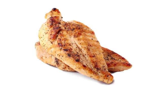 Roasted chicken breast fillets on white background Roasted chicken breast fillets isolated on white background grilled chicken breast stock pictures, royalty-free photos & images