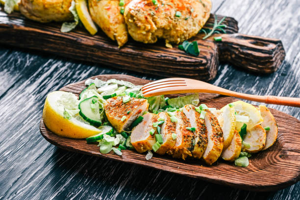 Roasted chicken breast on rustic wood stock photo