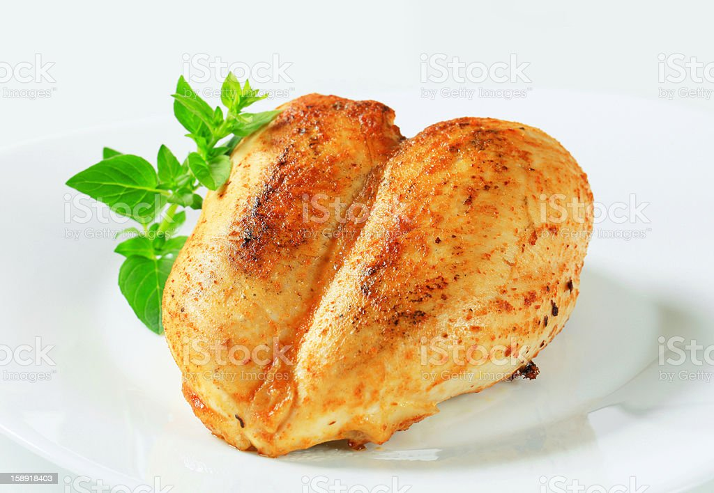 Roasted chicken breasts stock photo