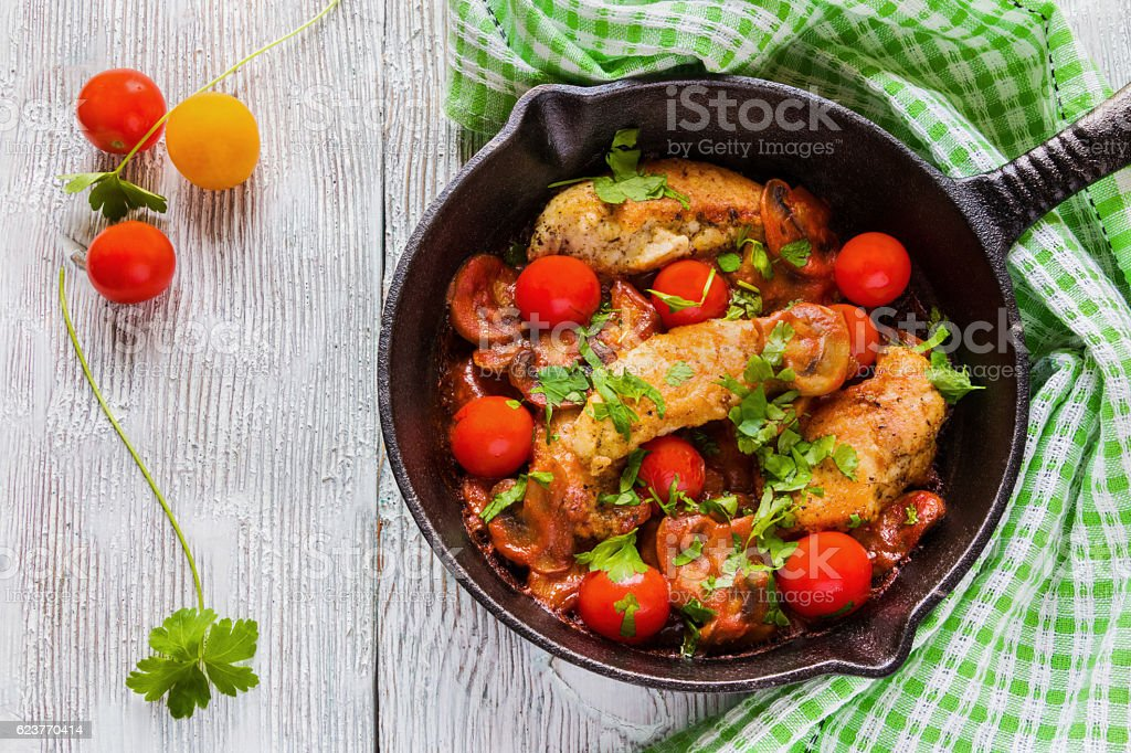 Roasted chicken fillet, cooked with mushrooms and tomatoes stock photo
