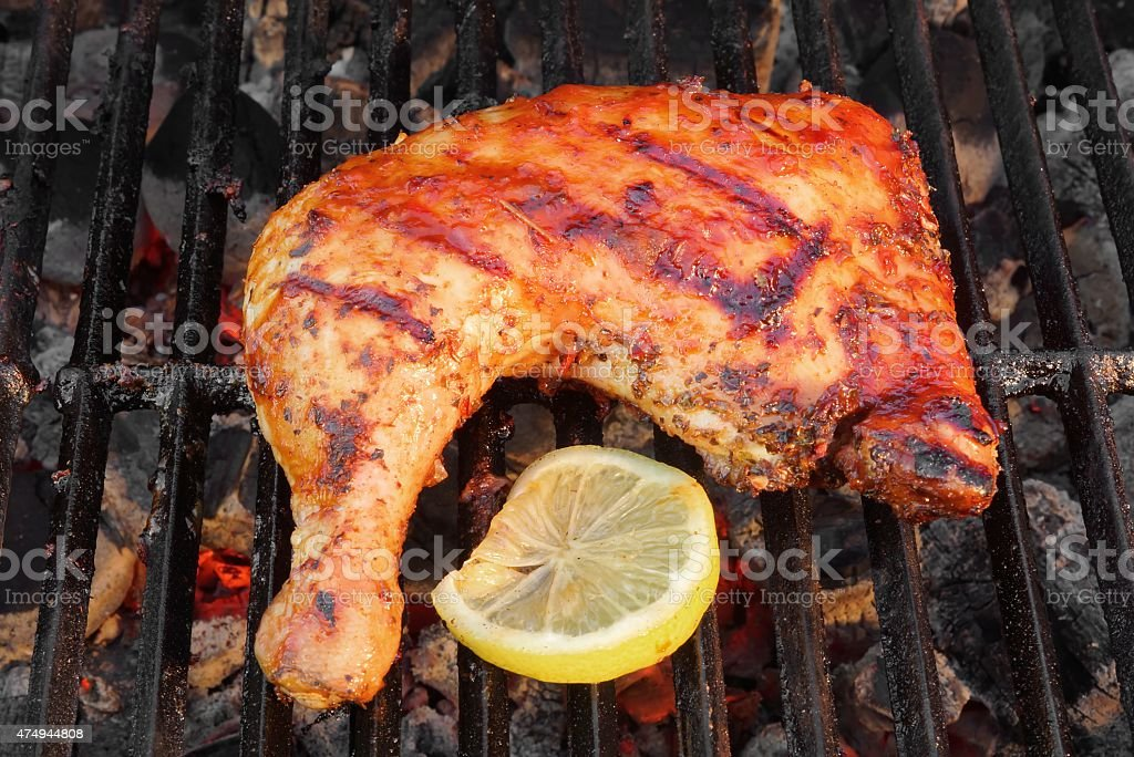 Bbq Roasted Chicken Leg Quarter On The Hot Grill Stock Photo Download Image Now Istock
