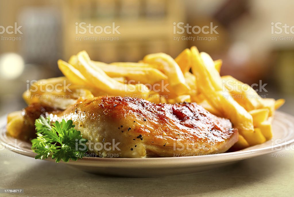 roasted chicken leg with fries potato royalty-free stock photo