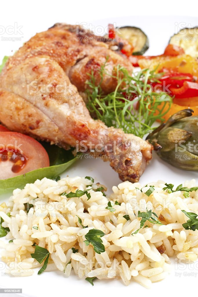 roasted chicken leg with rice and vegetables royalty-free stock photo