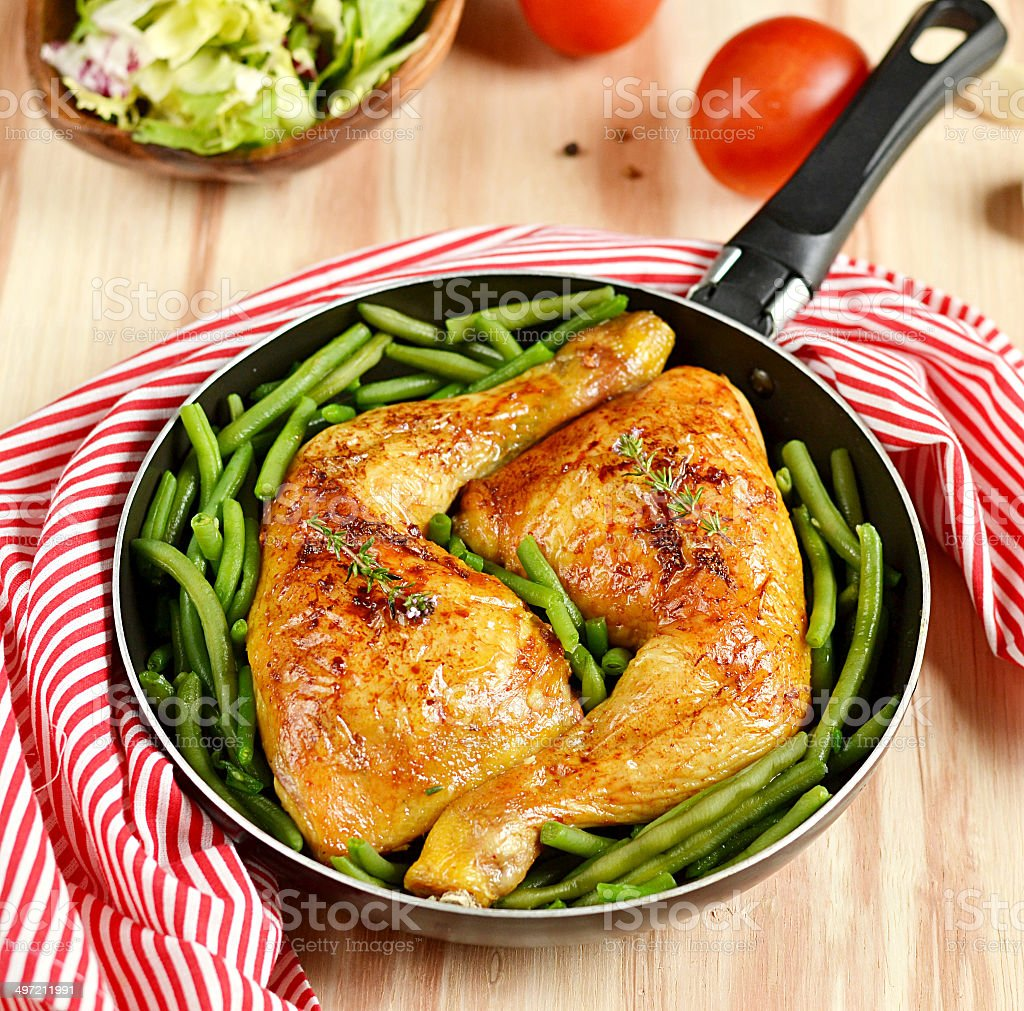 Roasted chicken legs with green beans stock photo
