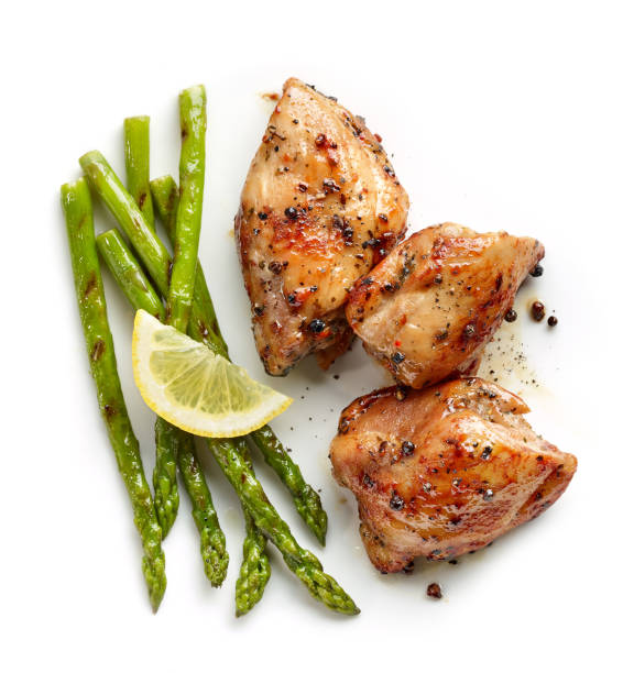 roasted chicken meat roasted chicken meat and grilled asparagus isolated on white background, top view grilled chicken breast stock pictures, royalty-free photos & images