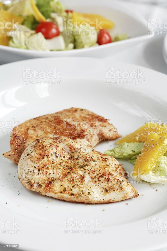 Roasted chicken medallions royalty-free stock photo