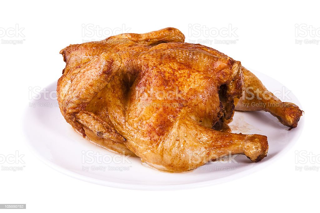 Roasted chicken on plate royalty-free stock photo