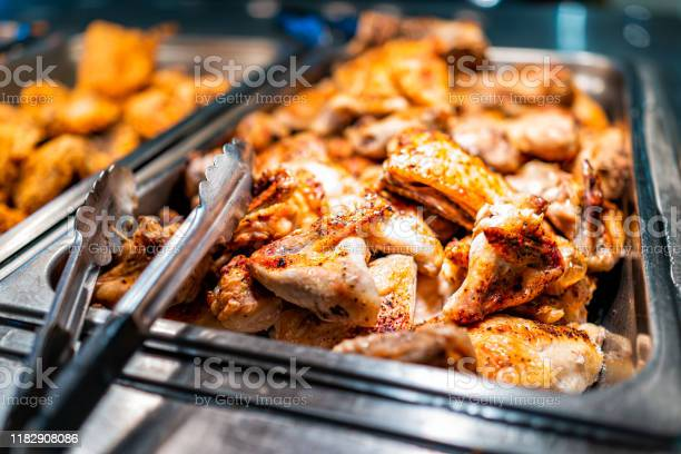 Roasted chicken wings buffet bar self serve with tongs in grocery picture id1182908086?b=1&k=6&m=1182908086&s=612x612&h=0ggjdzzjh4 5mdgyne3qf23kw9kzrbwqpbqhwhqbi60=