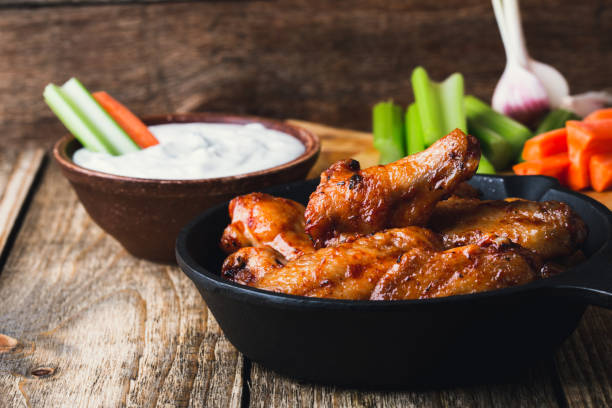 roasted chicken wings with carrots, celery sticks and dipping sauce - animal wing stock pictures, royalty-free photos & images