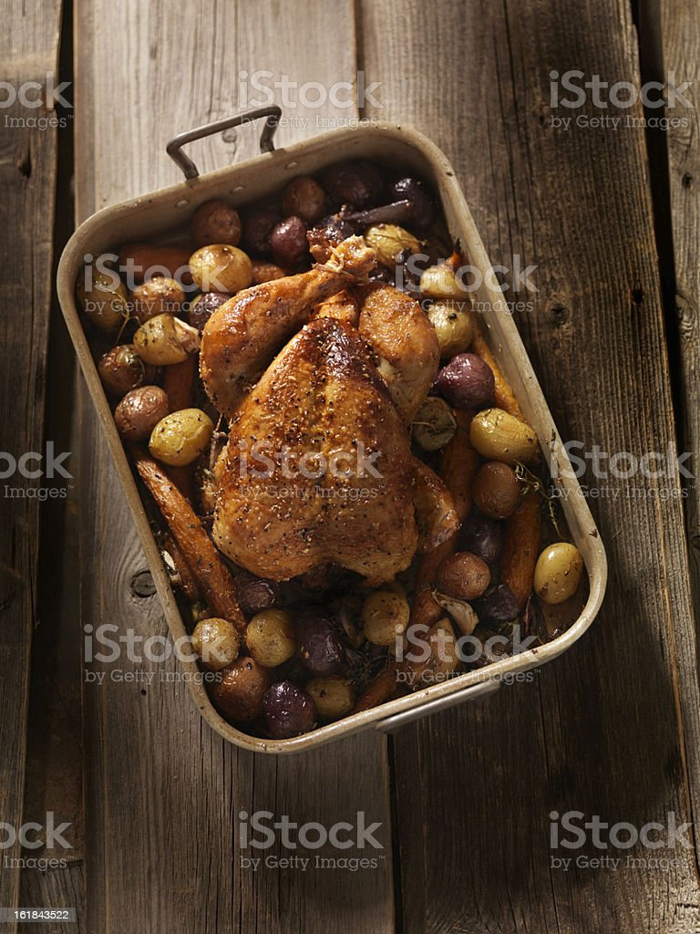 Roasted Chicken with Carrots and Potatoes royalty-free stock photo