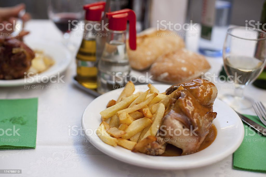 Roasted chicken with french fries royalty-free stock photo