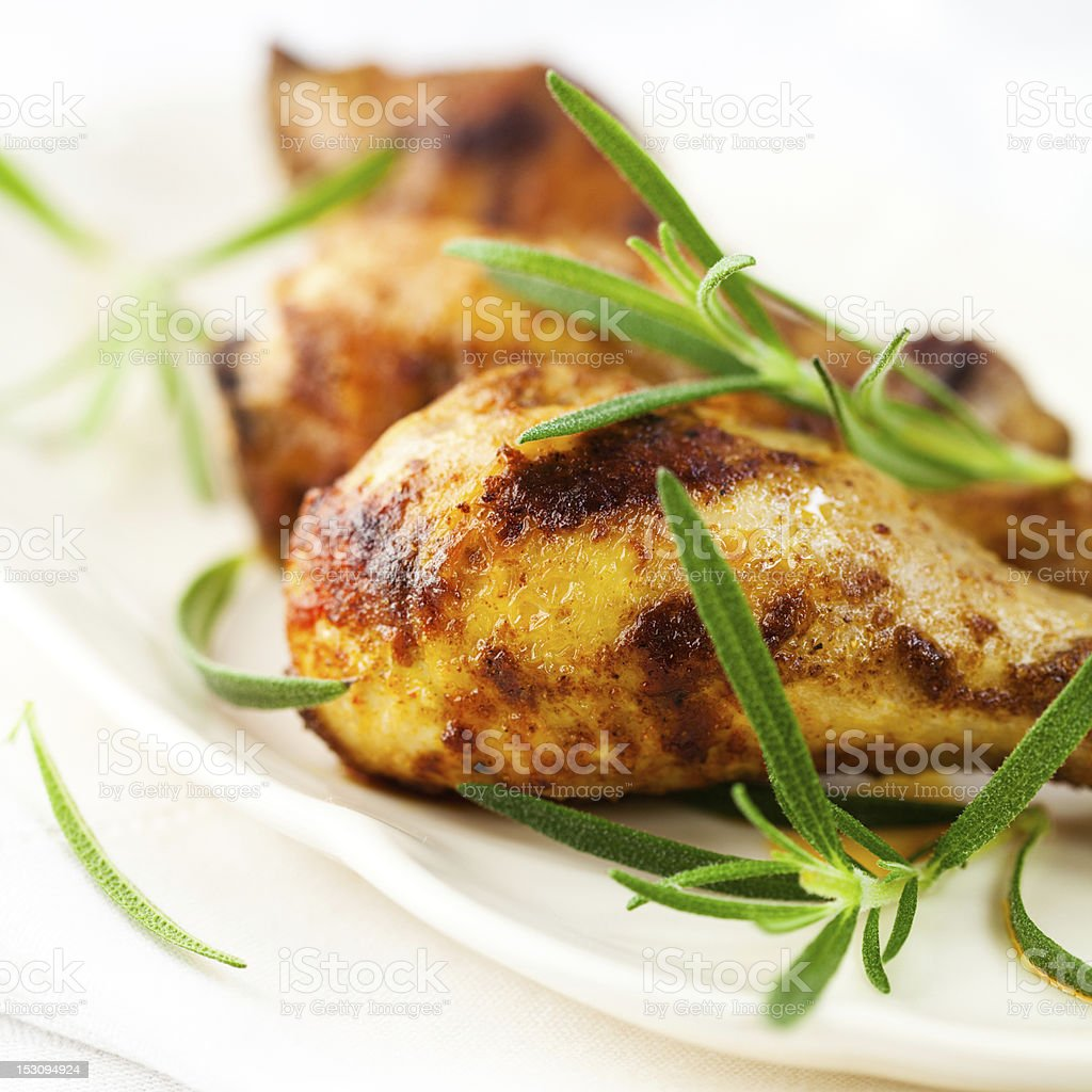 Roasted chicken with fresh rosemary stock photo