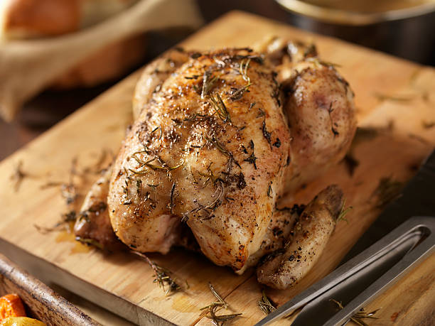 Roasted Chicken with Fresh Thyme  carving knife stock pictures, royalty-free photos & images